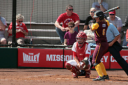09 May 2014:  Stephanie Gallant signals the call to Regan Romshek as Annie Korth steps into the batters box during an NCAA Missouri Valley Conference (MVC) Championship series women's softball game between the Loyola Ramblers and the Illinois State Redbirds on Marian Kneer Field in Normal IL