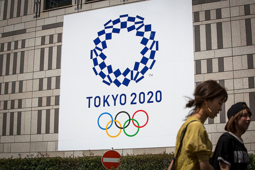 TOKYO, JAPAN - JULY 31 : A woman walk past at the Tokyo Olympic Games logo at Tokyo Metropolitan Government Office building at Shinjuku, Tokyo, Japan on Sunday morning, July 31, 2016. Tokyo's more than 11 million eligible residents will decide today for a new Governor of Tokyo who will deal with improving social welfare in Japan's increasingly aging society and issues related to the hosting of the Tokyo Summer Olympics and Paralympics in 2020.  (Photo: Richard Atrero de Guzman/NUR Photo)