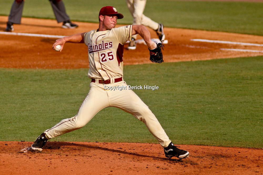 June 05, 2011; Tallahassee, FL, USA; Florida State Seminoles pitcher Mike McGee (25) throw against the Alabama Crimson Tide during the second inning of the Tallahassee regional of the 2011 NCAA baseball tournament at Dick Howser Stadium. Mandatory Credit: Derick E. Hingle