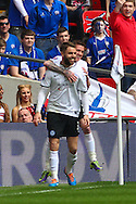 Josh McQuoid of Peterborough United (front) celebrates scoring the opening goal during the Johnstone's Paint Trophy Final match at Wembley Stadium, London<br /> Picture by David Horn/Focus Images Ltd +44 7545 970036<br /> 30/03/2014