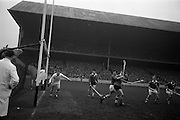 17/03/1965<br /> 03/17/1965<br /> 17 March 1965<br /> Railway Cup Hurling final  Munster v Leinster at Croke Park, Dublin. Relief for Leinster as the pass passes harmlessly wide.