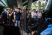 Police confront protesters as they occupy a bridge in front of the Central Government Offices, during a protest against a proposed extradition law in Hong Kong, SAR China, on Wednesday, June 12, 2019. Hong Kong's legislative chief postponed the debate on legislation that would allow extraditions to China after thousands of protesters converged outside the chamber demanding the government to withdraw the bill. Photo by Suzanne Lee/PANOS