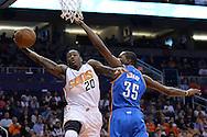 Feb 8, 2016; Phoenix, AZ, USA; Phoenix Suns guard Archie Goodwin (20) drives the ball against Oklahoma City Thunder forward Kevin Durant (35) at Talking Stick Resort Arena. Mandatory Credit: Jennifer Stewart-USA TODAY Sports