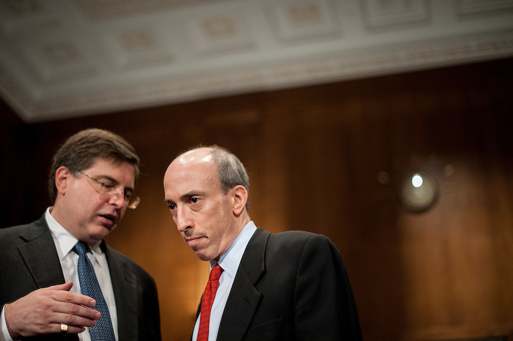 Robert Cook, SEC Director of Trading and Markets and Gary Gensler, chairman of the Commodity Futures Trading Commission, confer before a Senate Banking, Housing and Urban Affairs Committee on Tuesday on Captiol Hill. The committee held the hearing about implementing derivatives reform and reducing systemic risk and improving market oversight.