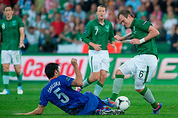 10.06.2012, Staedtisches Stadion, Posen, POL, UEFA EURO 2012, Irland vs Kroatien, Gruppe C, im Bild VEDRAN CORLUKA, GLENN WHELAN // during the UEFA Euro 2012 Group C Match between Ireland and Croatia at the Municipal Stadium Poznan, Poland on 2012/06/10. EXPA Pictures © 2012, PhotoCredit: EXPA/ Newspix/ Jakub Kaczmarczyk..***** ATTENTION - for AUT, SLO, CRO, SRB, SUI and SWE only *****
