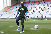 Wigan Athletic defender Cedric Kipre (21) warming up during the EFL Sky Bet Championship match between Wigan Athletic and Nottingham Forest at the DW Stadium, Wigan, England on 20 October 2019.