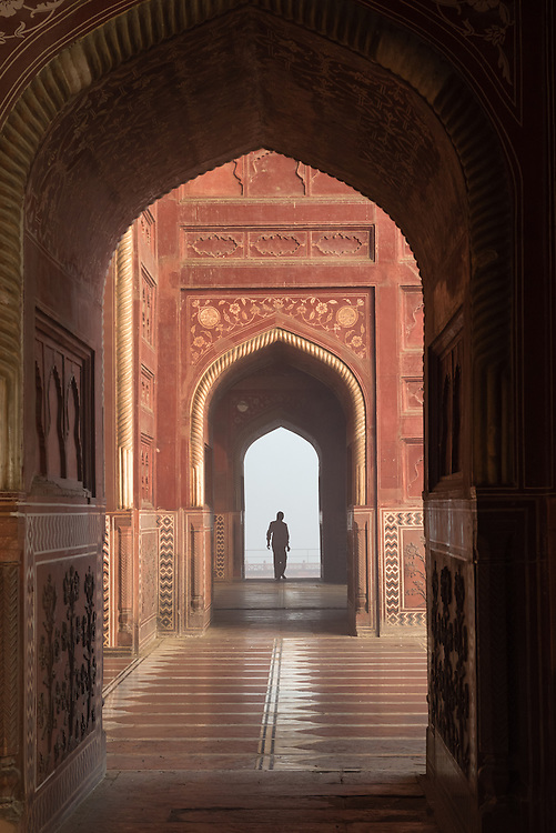 Figure in archway at Taj Mahal, India