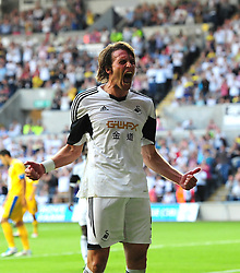 "Swansea City's Michu celebrates  - Photo mandatory by-line: Joe Meredith/JMP - Tel: Mobile: 07966 386802 22/08/2013 - SPORT - FOOTBALL - Liberty Stadium - Swansea -  Swansea City V Petrolul Ploiesti - Europa League Play-Off EDITORIAL USE ONLY. No use with unauthorised audio, video, data, fixture lists, club/league logos or ""live"" services. Online in-match use limited to 45 images, no video emulation. No use in betting, games or single club/league/player publications"