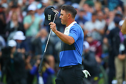 May 19, 2019 - Farmingdale, NY, U.S. - FARMINGDALE, NY - MAY 19:  Brooks Koepka of the United States salutes the fans after winning the 2019 PGA Championship at the Bethpage Black course with a score of 8 under par on May 19, 2019 in Farmingdale, New York.(Photo by Rich Graessle/Icon Sportswire) (Credit Image: © Rich Graessle/Icon SMI via ZUMA Press)