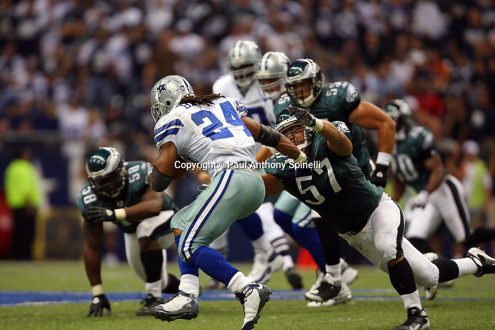 IRVING, TX - SEPTEMBER 15:  Running back Marion Barber of the Dallas Cowboys runs the ball while trying to avoid a tackle by linebacker Chris Gocong #57 of the Philadelphia Eagles at Texas Stadium on September 15, 2008 in Irving, Texas. The Cowboys defeated the Eagles 41-37. ©Paul Anthony Spinelli *** Local Caption *** Marion Barber;Chris Gocong