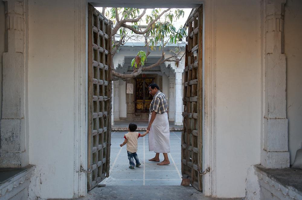 A father takes his son to the Hanuman Mandir hindu temple.