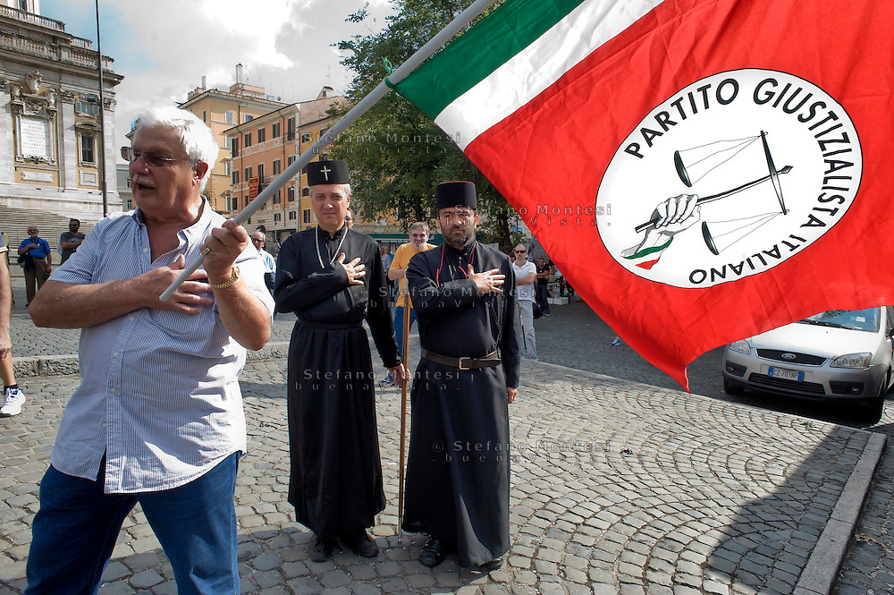 Roma 6 Settembre 2014<br />  Prima manifestazione nazionale &quot;Orgoglio Italiano&quot;.<br /> Per dire basta allo stupro della nostra patria, all' illeggittimit&agrave; della classe politica, per chiedere le dimissioni del governo, e la chiusura immediata delle frontiere italiane. Due rappresentanti  della Chiesa Ortodossa Italiana, con la mano sul cuore mentre suona   l'inno nazionale.<br /> Rome September 6, 2014 <br />  First national demostration  &quot;Italian Pride&quot;. <br /> To say stop the rape of our country, to illegitimacy of the political class, to demand the resignation of the government, and the immediate closure of the Italian borders. Two representatives of the Orthodox Church Italian, with his hand on his heart while the national anthem plays.