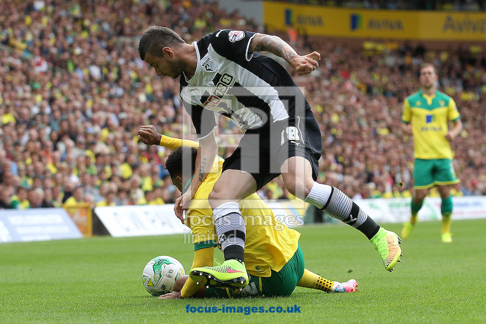 Daniel Pudil of Watford fouls Nathan Redmond of Norwich during the Sky Bet Championship match at Carrow Road, Norwich<br /> Picture by Paul Chesterton/Focus Images Ltd +44 7904 640267<br /> 16/08/2014