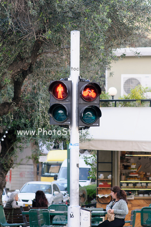 Red Pedestrian and bicycle traffic light. As bicycle riding is becoming more popular special bicycle lanes are being built. Right of way is being managed with special lights for bicycles, pedestrians and cars. Photographed in Tel Aviv, Israel