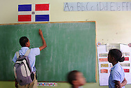 Robinson Martinez, 15, draws on a chalkboard before school begins in Santiago, Dominican Republic. In the mornings he attends Acción Callejera (Street Action), an organization dedicated to helping child laborers and give them a new purpose in life. Many child laborers drop out of school and continue the cycle of poverty. Acción Callejera helps to give the children the opportunity to continue their education and gives them a safe space to play, heal and learn. Sara A. Fajardo/Catholic Relief Services