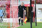 referee assistant gavin muge checks the net during the Sky Bet Championship match between Brentford and Brighton and Hove Albion at Griffin Park, London, England on 26 December 2015.