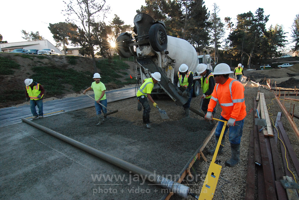 The San Benito Supply construction crew levels the first pour of pervious concrete on Tuesday morning, October 27th, 2015 at the Acosta Plaza Recreation Area in east Salinas, CA.