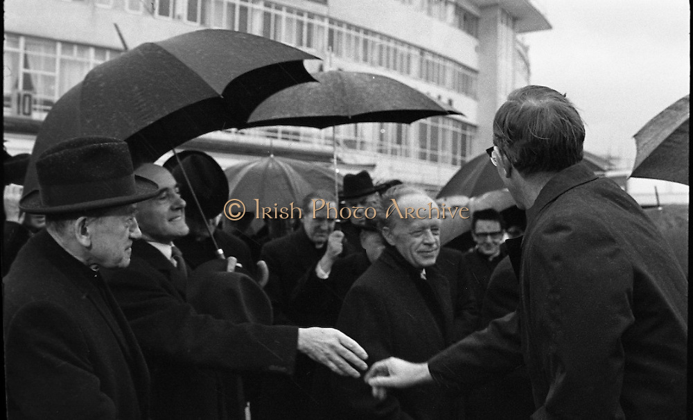 Archbishop Ryan Returns From Rome..1972..16.02.1972..02.16.1972..16th February 1972..After his official appointment as Archbishop of Dublin by Pope Paul VI, Dr Dermot Ryan returned to Dublin for his installation as Archbishop on Feb 22nd at the Pro Cathedral,Dublin..Image of An Taoiseach Mr Erskine Childers as he greets the new Archbishop of Dublin,Dr Dermot Ryan on his arrival at Dublin Airport.Dr Ryan had just arrived from Rome following his official appointment.