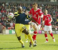 Photo: Aidan Ellis.<br /> Barnsley v Derby County. Coca Cola Championship. 31/03/2007.<br /> Derby's Darren Moore (L) holds off Barnsley's Istvan Ferenczi