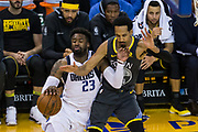 Golden State Warriors guard Shaun Livingston (34) fouls Dallas Mavericks guard Wesley Matthews (23) at Oracle Arena in Oakland, California, on February 8, 2018. (Stan Olszewski/Special to S.F. Examiner)