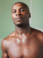 Bare-chested boxer portrait