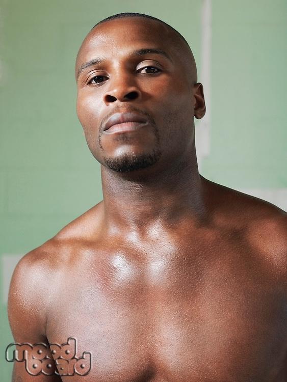 Bare-chested boxer portrait