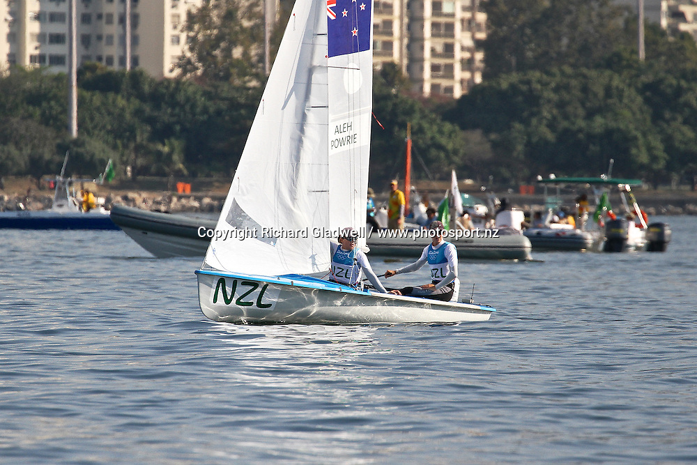Jo Aleh and Polly Powrie wait for the breeze ahead of their Medal Race, with the part of the media boat flotilla behind them.<br /> Copyright photo: Richard Gladwell / www.photosport.nz