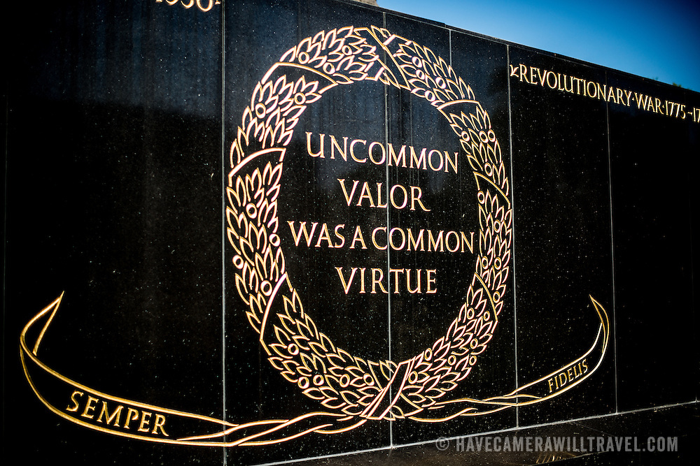 "One of the two inscriptions on the base of the Iwo Jima Memorial (formally the Marine Corps War Memorial) in Arlington, Virginia, next to Arlington National Cemetery. It reads: ""Uncommon valor was a common virtue,"" a tribute by Admiral Chester Nimitz to the fighting men on Iwo Jima. The monument was designed by Felix de Wledon and is based on an iconic Associated Press photo called the Raising the Flag on Iwo Jima by Joe Rosenthal. It was dedicated in 1954."