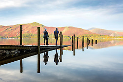 © Licensed to London News Pictures. 15/10/2018. Keswick UK. Two ladies prepare for an early morning swim in Derwentwater just after sunrise this morning on a cold start to the day in Keswick, Cumbria. Photo credit: Andrew McCaren/LNP