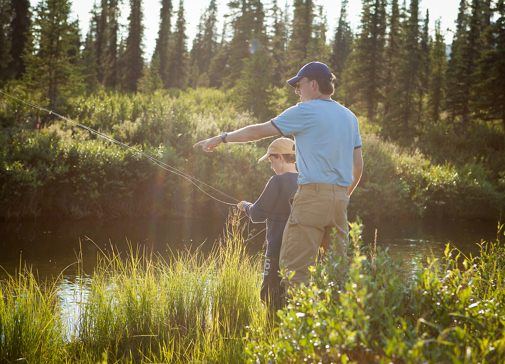 George Rogers teaching his 8 year old son, Callahan to fly fish for grayling in a small tundra stream in Alaska
