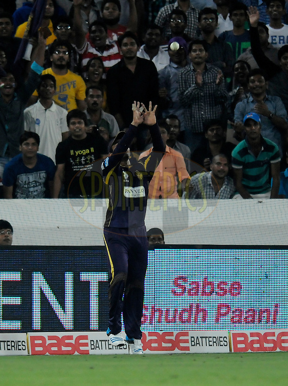 Robin Uthappa of Kolkata Knight Riders takes a catch to get the wicket of Ahmed Shehzad of Lahore Lions during match 7 of the Oppo Champions League Twenty20 between the Kolkata Knight Riders and the Lahore Lions held at the Rajiv Gandhi Cricket Stadium, Hyderabad, India on the 21st September 2014<br /> <br /> Photo by:  Pal Pillai / Sportzpics/ CLT20<br /> <br /> <br /> Image use is subject to the terms and conditions as laid out by the BCCI/ CLT20.  The terms and conditions can be downloaded here:<br /> <br /> http://sportzpics.photoshelter.com/gallery/CLT20-Image-Terms-and-Conditions-2014/G0000IfNJn535VPU/C0000QhhKadWcjYs