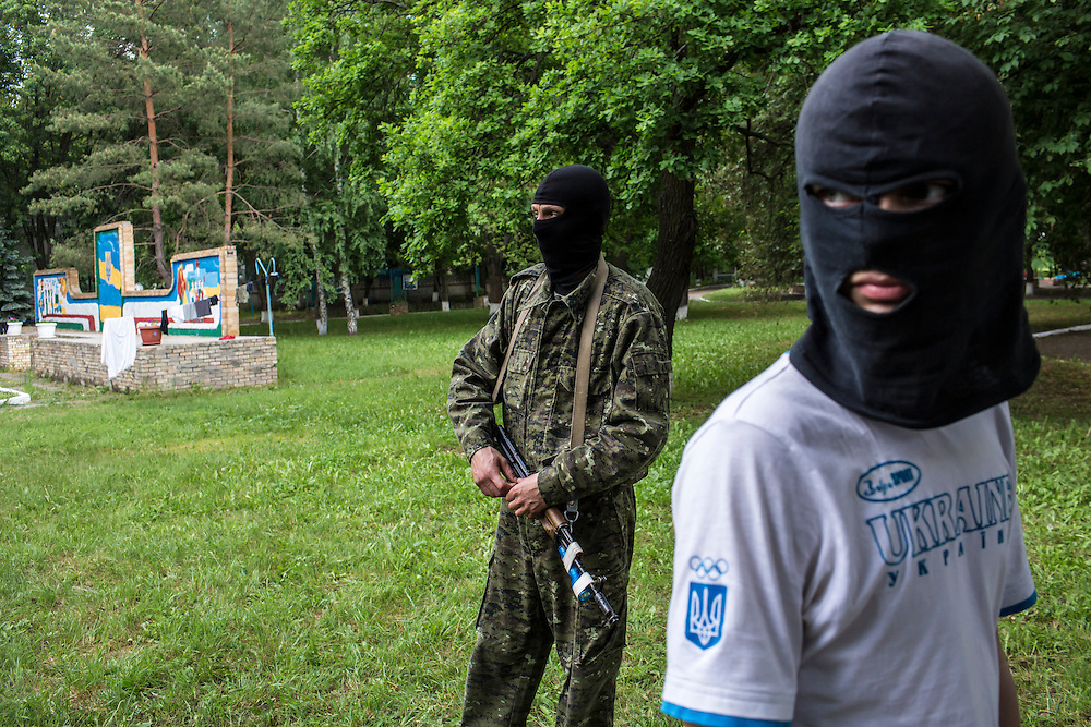 DNIPROPETROVSK REGION, UKRAINE - MAY 19: Recruits learn to use guns at a training camp for the Donbass Battalion, a pro-Ukrainian militia, on May 19, 2014 in Dnipropetrovsk Region, Ukraine. A week before presidential elections are scheduled, questions remain whether the eastern regions of Donetsk and Luhansk are stable enough to administer the vote. (Photo by Brendan Hoffman/Getty Images) *** Local Caption ***