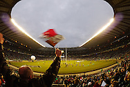 Picture by Andrew Tobin/Focus Images Ltd. 07710 761829. .27/12/11. A Harlequins supporter cheers and waves a flag before the Aviva Premiership match between Harlequins and Saracens at Twickenham Stadium, London.