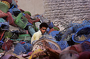 "Cairo, the last zabbalins,  Cairo's army of garbage people who make their living recycling rubbish. This is a traditional coptic christian minority activity. Coptics, Greek Orthodox, Syrians, only few components of the fragmented galaxy of the ""living stones"" as often are defined the oriental christian churches, are the protagonists of a frequently forgotten world that currently menaces to die in the same places in which Christianity born. Rituals and stories similar to legends lost in time survive intact and in these places regain the strenght of a living reality."