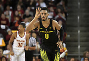 Feb 15, 2018; Los Angeles, CA, USA; Oregon Ducks forward Troy Brown (0) celebrates after a three-point basket in the second half against the Southern California Trojans during an NCAA basketball game at Galen Center. USC defeated Oregon 72-70.