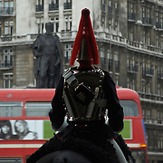 Red double decker bus passes Horse Guard on Whitehall, London, England, UK - no release available<br />