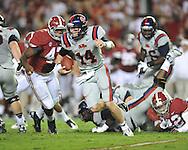 Ole Miss quarterback Bo Wallace (14) vs. Alabama linebacker Xzavier Dickson (47) at Bryant-Denny Stadium in Tuscaloosa, Ala. on Saturday, September 29, 2012. Alabama won 33-14. Ole Miss falls to 3-2.