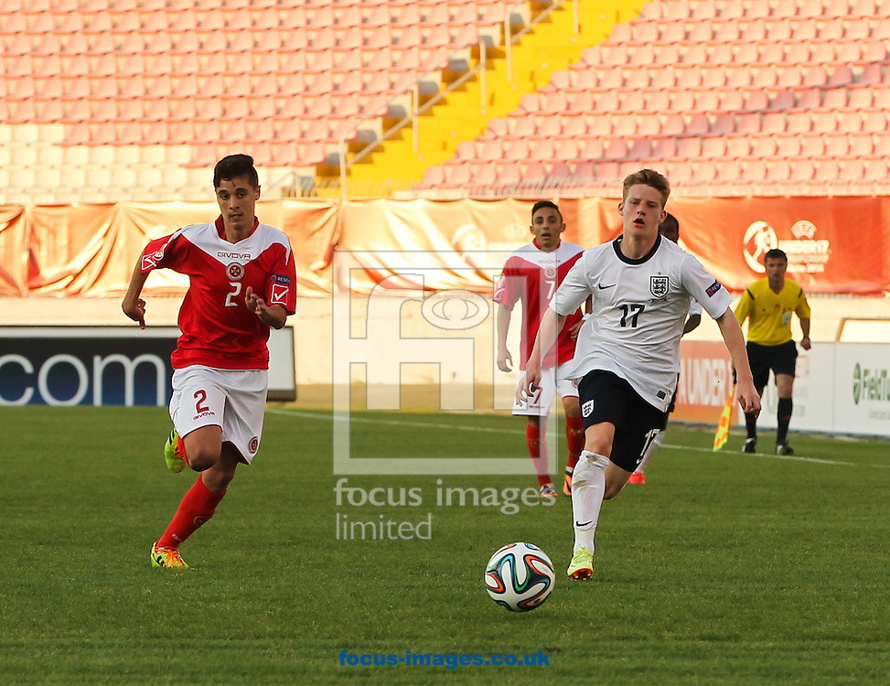 Daniel Buckle (left) of Malta and Joshua Sims (right) of England race to the ball during the 2014 UEFA European Under-17 match at Ta' Qali National Stadium, Attard<br /> Picture by Tom Smith/Focus Images Ltd 07545141164<br /> 09/05/2014
