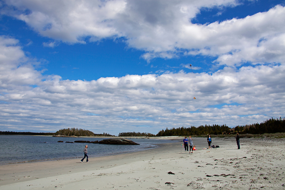 North America, Canada, Nova Scotia, Spry Bay. Kite Flying on a sandy beach at Taylor Head Provinicial Park.
