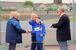 Coach and young boy with disability taking part in Mini games sports event held at Stoke Mandeville Stadium,