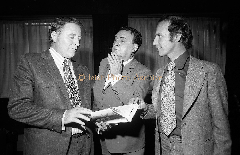 Michael Mac'Liamoir<br /> 1972.<br /> 24.07.1972.<br /> 07.24.1972.<br /> 24th July 1972.<br /> <br /> Image shows Michael MacLiamoir at the launch of the book about the life and times of the  renowned playwright and author ,John B Keane. Included in the picture are the book's authors Gus Smith and Des Hickey. The book launch was held in the Wicklow Hotel in Dublin.