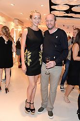 NOELLE RENO and SCOT YOUNG at the launch of the Benefit Global Flagship Boutique at 10 Carnaby Street, London on 11th September 2013.