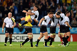 Romania players celebrate at the final whistle - Mandatory byline: Patrick Khachfe/JMP - 07966 386802 - 06/10/2015 - RUGBY UNION - Leicester City Stadium - Leicester, England - Canada v Romania - Rugby World Cup 2015 Pool D.