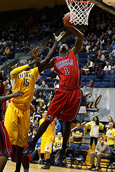 March 16, 2011; Berkeley, CA, USA;  Mississippi Rebels forward Terrance Henry (1) grabs a rebound in front of California Golden Bears forward Bak Bak (15) during the first half of the first round of the National Invitation Tournament at Haas Pavilion.