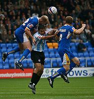 Photo: Steve Bond.<br /> Shrewsbury Town v Chesterfield. Coca Cola League 2. 13/10/2007. Jack Lester (C) is beaten in the air by Colin Murdock (L)