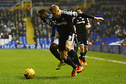 Birmingham City midfielder Jacques Maghoma and Brentford defender Jake Bidwell tussle during the Sky Bet Championship match between Birmingham City and Brentford at St Andrews, Birmingham, England on 2 January 2016. Photo by Alan Franklin.