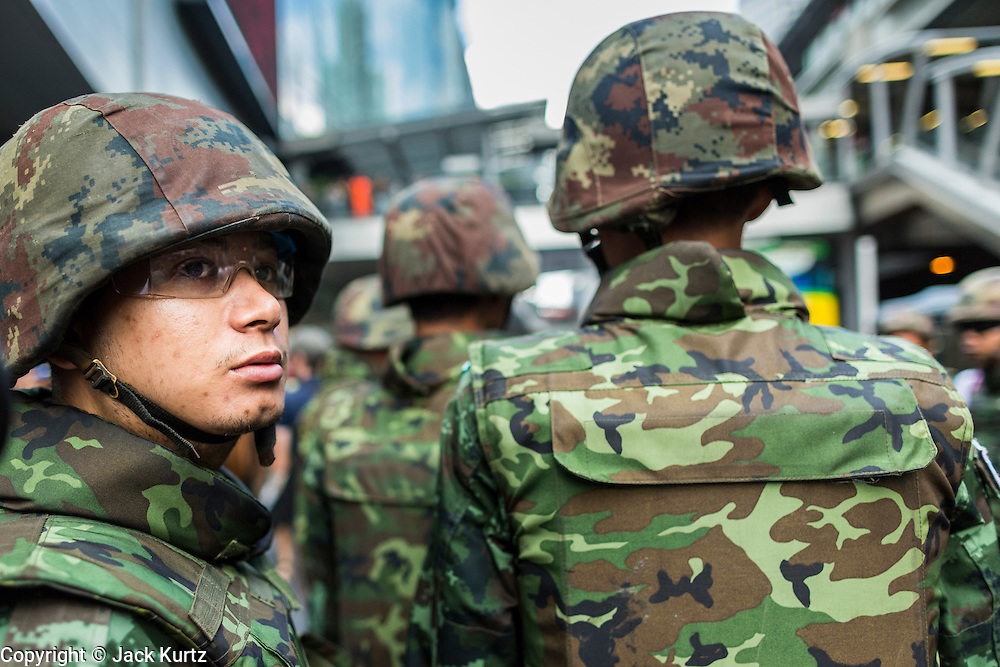 "01 JUNE 2014 - BANGKOK, THAILAND: Thai soldiers on patrol at Terminal 21, a Bangkok shopping mall, after a flash mob protested against the coup in the mall. The Thai army seized power in a coup that unseated a democratically elected government on May 22. Since then there have been sporadic protests against the coup. The protests Sunday were the largest in several days and seemed to be spontaneous ""flash mobs"" that appeared at shopping centers in Bangkok and then broke up when soldiers arrived. Protest against the coup is illegal and the junta has threatened to arrest anyone who protests the coup. There was a massive security operation in Bangkok Sunday that shut down several shopping areas to prevent the protests but protestors went to malls that had no military presence.    PHOTO BY JACK KURTZ"