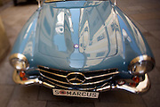 Oldtimers of mainly Austrian origin on display in front of Mariahilferkirche to honour Austrian car pioneer Siegfried Marcus' 175th birthday. Marcus built the first car ever in 1870 in his nearby workshop at Mariahilferstrasse 107..Mercedes-Benz 230SL cabriolet ca. 1960.