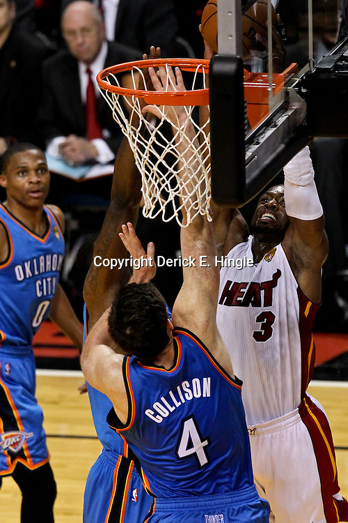 Jun 19, 2012; Miami, FL, USA; Miami Heat shooting guard Dwyane Wade (3) dunks against the Oklahoma City Thunder during the first quarter in game four in the 2012 NBA Finals at the American Airlines Arena. Mandatory Credit: Derick E. Hingle-US PRESSWIRE