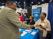 Houston ISD staff talk with potential vendors during the Houston Minority Supplier Development Council expo at the George R. Brown Convention Center, September 25, 2014.